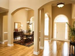 Interesting Modern Entrance Design Idea With Dining Table And White Arched Door