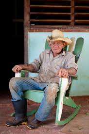 100 Cowboy In Rocking Chair Tobacco Farmer Wearing Straw Hat And Wellington Boots On A Rocking