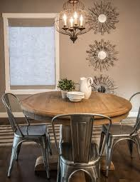Rustic Industrial Design Dining Room With Modern Onion Shaped Chandelier Round Sculptures