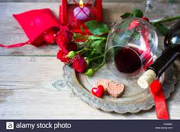 Table Setting For St Valentines Day With Glasses Of Red Wine Present Box And Roses In Rustic Style