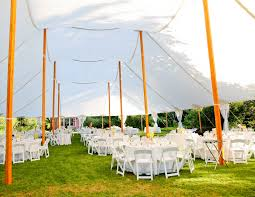 White Garden Chairs In A Tidewater Sailcloth Tent