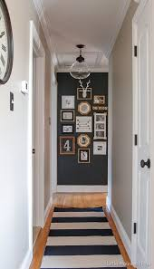 A Hallway Gets Major Update With Paint Thrifted Finds And Inexpensive Dollar Store Frames