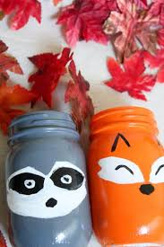 Simple DIY Fox And Raccoon Woodland Creatures Painted Mason Jars For Your Kids Room Or Fall