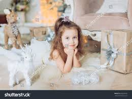 beautiful girl white dress christmas stock photo 602858702