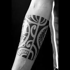 Quarter Sleeve Male Black Ink Hawaiian Style Tribal Forearm Tattoos