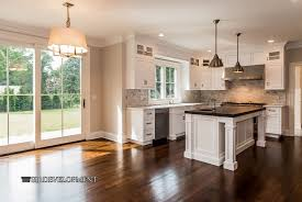 traditional kitchen with pendant light glass panel in westport