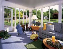 Screened Porch Decorating Ideas Pictures by Sunroom Screened Porch Decorating Ideas With Sofa And Glass Wall