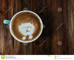 Download Cute Cat Face Latte Art Coffee In White Cup Stock Image