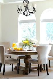Round Dining Table Centerpieces How To Decorate A Elegant Room Iron Chandelier And Contemporary Chairs