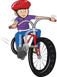 Boy Riding A Bike Wearing Helmet