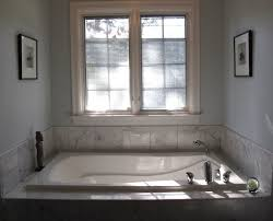 bathtubs bathroom contemporary with beige tile wall blue