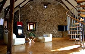 Living Room With Fireplace by View Of Living Room With Fireplace And Old Stone Wall And Modern
