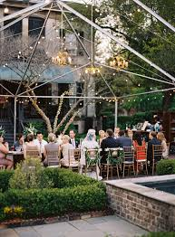 gorgeous outdoor reception under an open air tent frame with gold