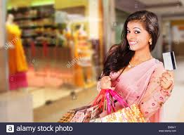 indian beautiful ladies shopping with credit card stock photo