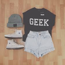A Cute Summer Outfit Black Geek Top With Some High Wasted Shorts Fringes At The Bottom Also Grey Beanie And White Converse