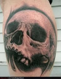 Black Simple Skull Tattoo On Leg