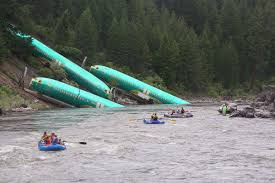 Spirit Halloween Missoula by Crews Pulling Plane Fuselages From Montana River After Train