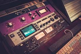 Close Up Professional Audio Equipment With Sliders And Knobs At Boutique Recording Studio Stock