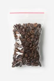 Download Plastic Transparent Zipper Bag With Full Wholegrain Coffee Beans Isolated On White Vacuum Package