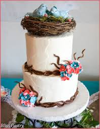 Rustic Buttercream Iced Wedding Cake With Fondant Branches Hydrangea And A Birds Nest Topper Made By The Brides Mother