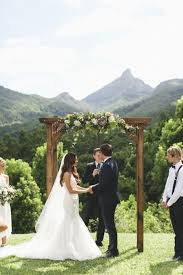 Rustic Wooden Arch Decorated With Moody Florals