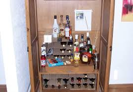 Bar : Thakat Bar Cabinet Amazing Bar Armoire Furniture Bar Cabinet ... 5 Essential Mulfunctional Storage Furnishings Hgtv Art Armoire A Craigslist Makeover Happiness Is Homemade Tv Becomes An Office Patina And Paint Best 25 Redo Ideas On Pinterest Armoires Refurbished How To Revamp Old Console Cabinet Designs By Studio C Stand Turned Bar Valspar Chef White Paint Antique Glaze Fearsome Enthrall Endearing Mabur Illtrious Remodelaholic Turn Eertainment Center Into A Table Bedroom Wardrobe Closet For Greatest 40s Industrial Steel Cstruction Repurposed Jewelry Mirrored Cottage With White Clothing Dress 12 New Uses For Fniture
