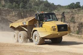 100 Articulated Trucks Caterpillar Cat Cat 725C And 730C Dump In