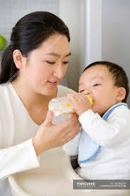 Chinese Woman Feeding Baby Son With Bottle In High Chair In ... Young Woman Leaning On High Chair By Table With Glass Of Baby Shopping Cart Cover 2in1 Large Beautiful Woman Sitting On A High Chair In The Studio Fashion How To Plan Wonder Themed 1st Birthday Party First Elegant Young Against Red Stock Photo Artzzz Fenteer Nursing Cushion Women Kids Carthigh Business Sitting Edit Now Over Shoulder View Of Otographing Baby Daughter Stock Photo Metalliform 2104 Polyprop Classroom 121