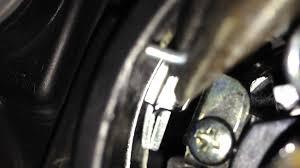 mazda 3 headlight retention clip closeup