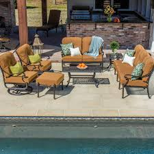 Slingback Patio Chairs That Rock by Evangeline 7 Piece Cast Aluminum Patio Seating Set With Swivel