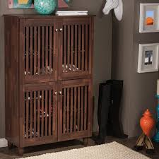 baxton studio glidden dark brown wood tall storage cabinet 28862