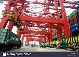 100 Surplus Trucks FILECranes Load Trucks With Containers At A Port In