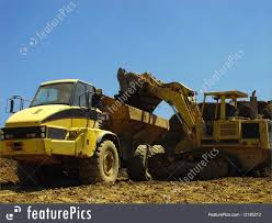 Excavator Loads Truck Picture Big Dump Truck Is Ming Machinery Or Equipment To Trans Tonka Classic Steel Mighty Dump Truck 354 Huge 57177742 Goes In The Evening On Highway Stock Photo Picture Minivan Stiletto Family Holidays Green Photos Images Alamy How Vehicle That Uses Those Tires Robert Kaplinsky Huge Sand Ez Canvas Excavator Loads 118 24g 6ch Remote Control Alloy Rc New Unturned Bbc Future Belaz 75710 Giant Dumptruck From Belarus Video Footage Dumper Winter Frost