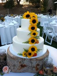 Wedding Cakes Adorned With Sunflowers Grown By The Bride Groom