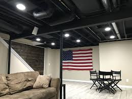 Exposed Basement Ceiling Lighting Ideas by Exposed Basement Ceiling Painted Black Basement Ideas