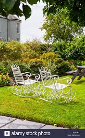 Pair Of Old Fashioned Vintage White Wrought Iron Rocking ... Agha Rocking Chair Outdoor Interiors Magnificent Wrought Iron Chairs Vintage Garden Table Black Leather Chaise Lounge Modern Fniture Living Wood And Amazonin Home Kitchen Victorian Peacock Lawn Patio Set Best Images About On 15 Collection Of 4 French Folding Metal Teak Seat Bistro Amazoncom Bs Antique Bronze Scoll Ornate Cast In Worsbrough South Yorkshire Gumtree Surprising Bedroom House Winsome