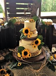 Rustic Wedding Cake And Cupcake Display With Live Sunflowers By MasterPieces Art