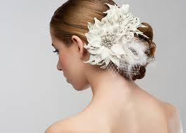 Bride Showing Off A Side Bun With Large Flower Adornment