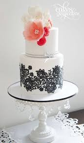 White and Black Lace Wedding Cake with Pink Sugar Flower Topper