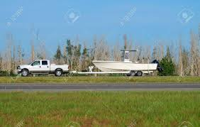Truck Towing Boat Stock Photo, Picture And Royalty Free Image. Image ... Dragon Boat Trailers Pan Am Track With Military Boat Stock Image Image Of Weapon 58136937 What Pulls Your Ptoon Deck Magazine Enigma Fishing Boosts Their Brand Truck And Graphics Boattowing Pickup Makes A Nerve Wracking Trip Across Water On The Ultimate Brojects Nettivaraosa Boattruck 750m Venetraileri Transport Dirt Every Day Extra Season October 2017 Episode 244 Is Whos Towing Larger Lifted Page 4 Offshoreonlycom Us Aussies Have Nice Trucks Boats As Well Trucks This Navyveteran Got New Lease On Life As Puller How