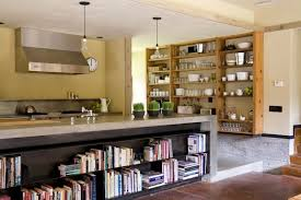 Multiple Shelving Units Provide Plenty Of Storage Space For This Kitchen The Large Countertop Features