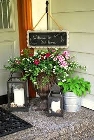 Candle Lanterns And Planters With Greenery Flowers Is All You Need To Refresh The Porch