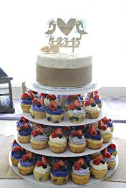 Wedding Cupcake Tower With Fruit Topped Cupcakes And Rustic Cutting Cake