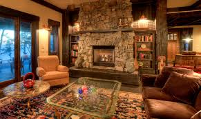 Living room with stone fireplace Rustic Living Room Seattle