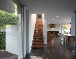Finest Wooden Stairs On The Grey Granite Floor For House With Minimalist Chandelier White Ceiling Flooring