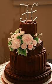 Four tier round chocolate wedding cake with monogram topper and fresh flowers JPG