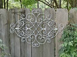 Gorgeous Fence Decor Which Is Made Of Metal Elements And Painted In Bright White Placed On