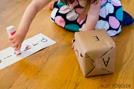 ALPHABET ROLL AND CROSS Check Out This Fun DIY Alphabet Game Thats Perfect For Toddlers