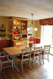 Gorgeous Hutch Creates A Cool And Colorful Backdrop In This Farmhouse Style Dining Space From