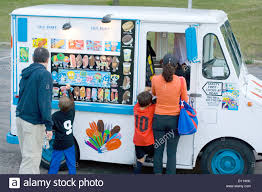 Children With Parents Patronizing A Mobile Ice Cream Truck. St Paul ...